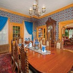 Reproduction wall and ceiling papers decorate the dining room and the music parlor beyond.