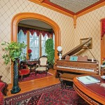 In the music room, the Krainiks also added Gothic-inspired pendants to the molding.