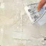 Scrape the joint compound with a putty knife