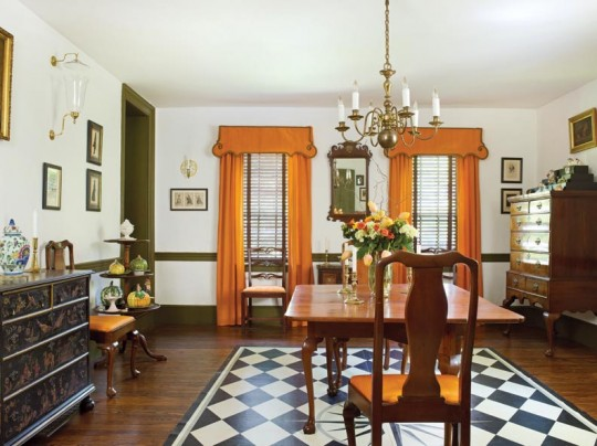 The formal dining room dates to renovations around 1840. The owner made the window treatments and the painted floorcloth.