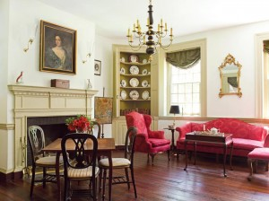 In the front parlor, the mantel and corner cabinet are examples of fine Federal woodworking.