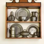 Collected pewter is displayed in a maple case the owner copied from a New England design.