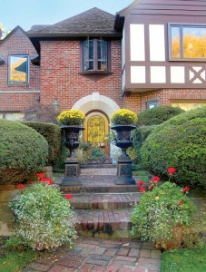 Plantings define space; antique iron urns add stately aplomb and seasonal color.