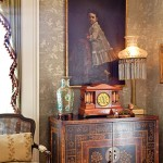 An 1880s portrait hangs above a chinoiserie chest.