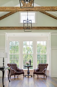 A pair of leather chairs sets a tone of intimacy in the main living space.