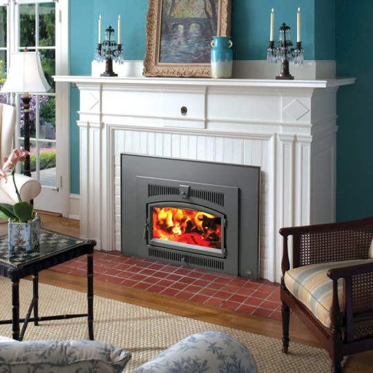 Lopi Stoves' Flush Wood Plus woodburning fireplace insert comes with a patented ignition system that starts the fire without the need to open the door, helping reduce smoke buildup.