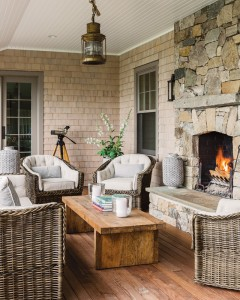 The screened-in portion of the porch is where many summer nights are spent chatting around the fire. Walters Wicker furniture is upholstered in Perennials indoor/outdoor fabric.