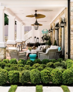 A favorite lounging space is under the deck, where indoor-outdoor wicker and ceiling fans speak the language of ease.