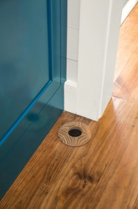 The only evidence of a mini-duct system like this one from Unico is a small circular vent that blends into the floor.
